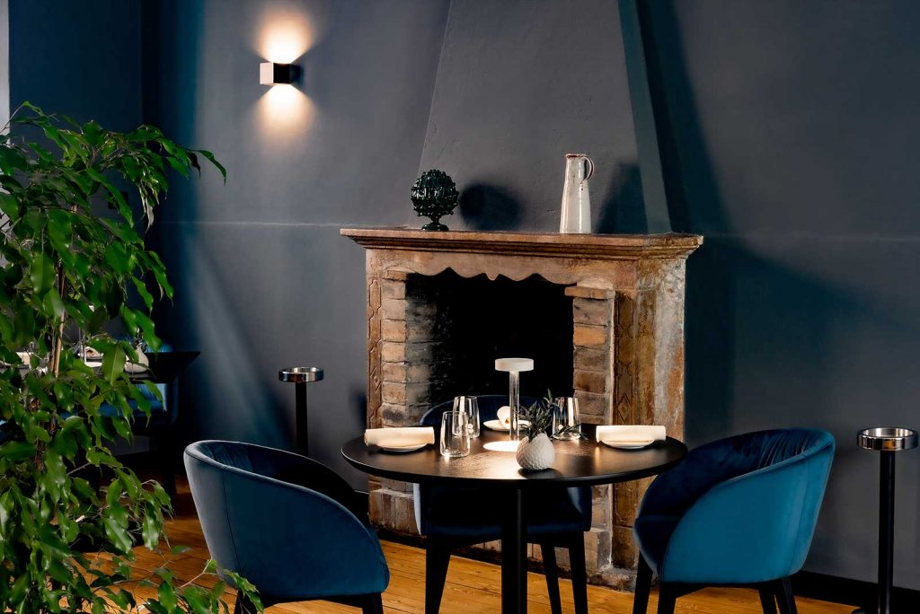 Vitium Restaurant by Michele Minchillo in Crema, Italy restaurant seating and fireplace mood